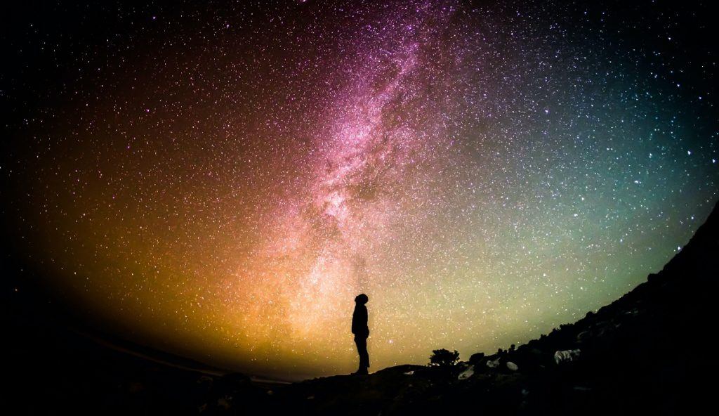 Person looking up at night sky
