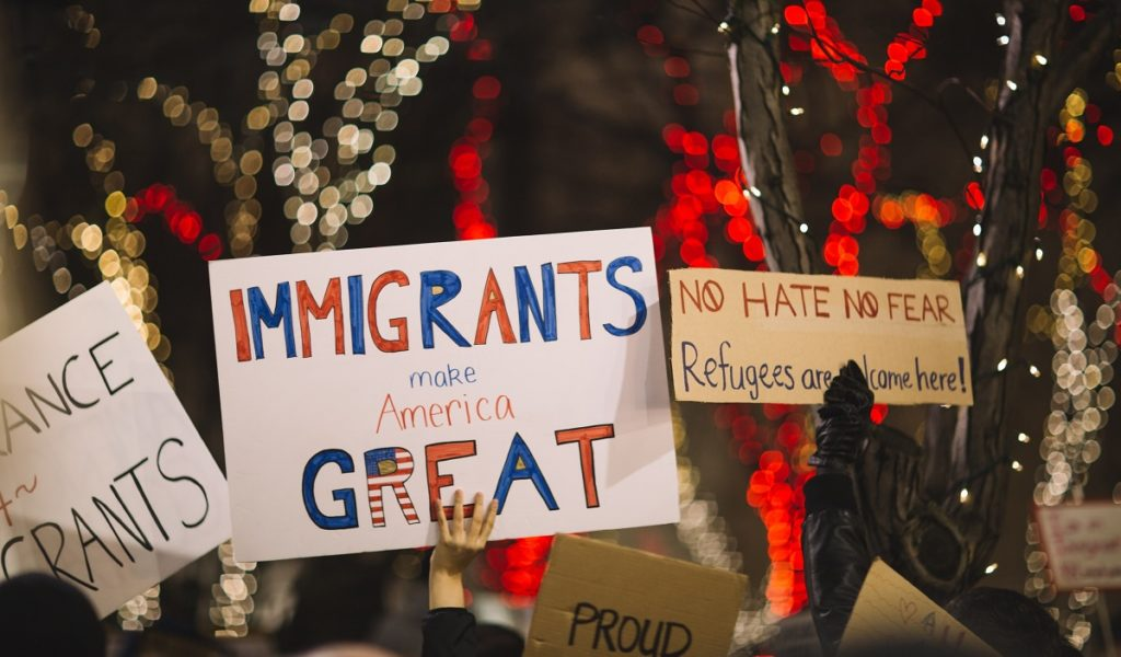 """Immigrants make America great"" sign"