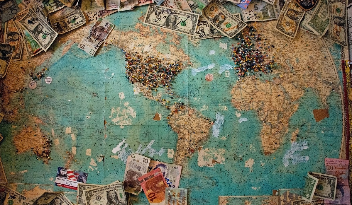 World map with money on it