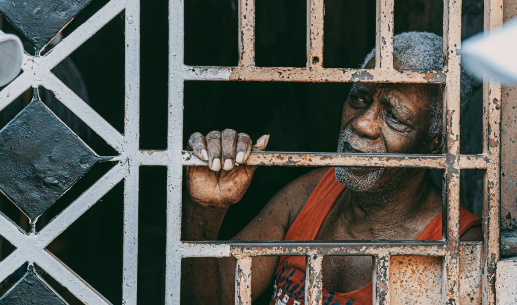 Black man behind bars