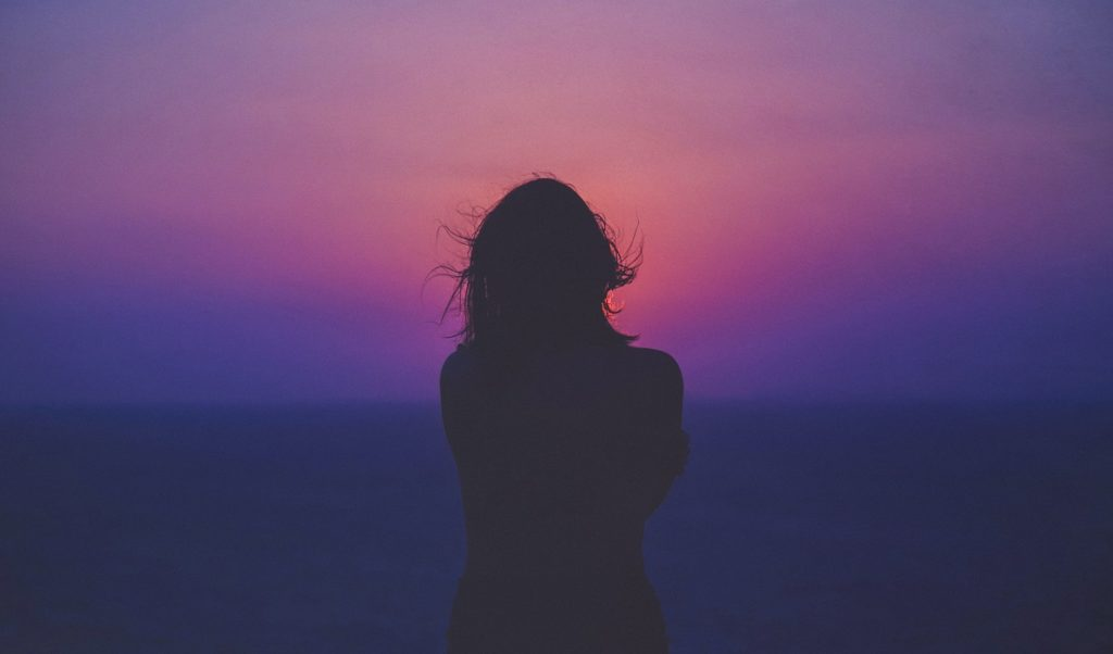 Woman's silhouette against sunet